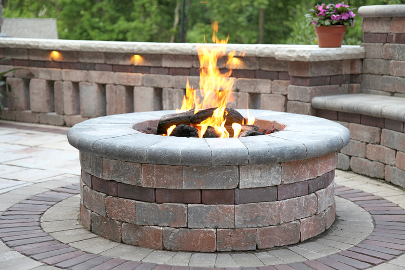 firepits with custom patios, walls, and lighting