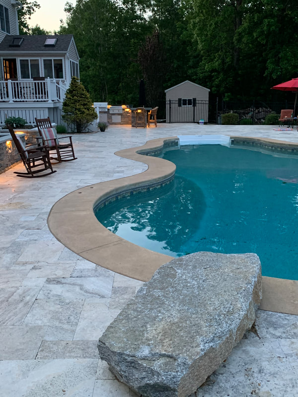 Outdoor kitchen, New England Ledgestone Veneer walls, granite stpes and wall caps, Silver Travertine marble pavers, landscape lighting, walkways, stpes, diving rock.