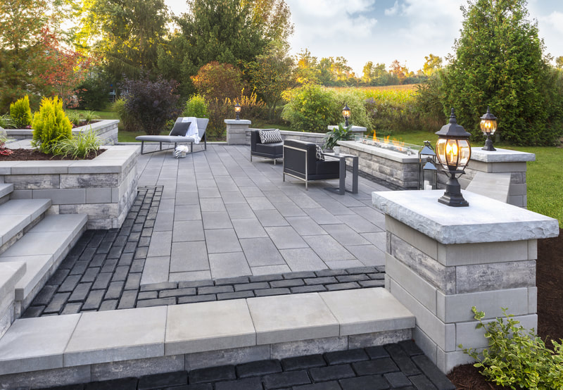 Custom patio, firepits, columns, walls, and landscaping